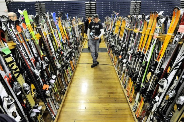 Photo by John Ewing/staff photographer... Saturday, November 26, 2011....The 50th Annual Down East Ski Sale held at the Portland Expo building.  About 10,000 items, from skis to boots, poles to bindings, googles and accessories.  Thousands of new skis filled aisles on the Expo floor.